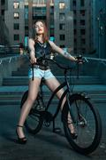 Girl on bicycle at night. Stock Photos