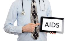 Doctor holding tablet - Aids - stock photo