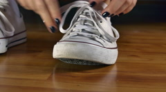 Young Woman Untying The Shoelaces Of Her Sport Shoes Stock Footage
