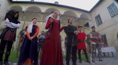 The queen is introducing the personell of the castle Stock Footage