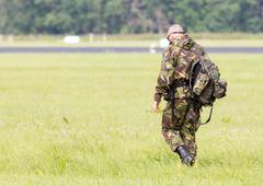LEEUWARDEN, THE NETHERLANDS - JUNE 9; Military guard walking at the runway du - stock photo