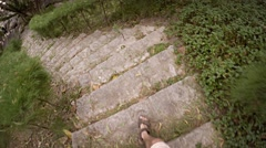 Man's Legs and Feet Descending an Outdoor, Stone Walkway Stock Footage