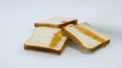 Pieces of fruit and some toast with honey Stock Footage