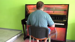 A man playing on a transparent piano Stock Footage