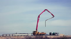 Mobile crane lifting generator on road construction site, contracting hand ji Stock Footage