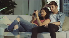 4K Affectionate couple relaxing at home & taking selfie with smartphone Stock Footage