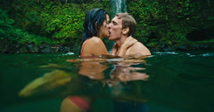 Couple Kissing Under Waterfall Stock Footage