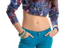 Girl wears floral crop top. Stock Photos