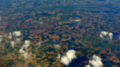 4K Farmers Fields as Seen From Aerial View High Above the Clouds - stock footage