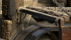 Close up of drive belts and wheels at a huon pine sawmill Stock Footage