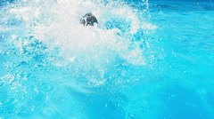 Man diving in swimming pool Stock Footage