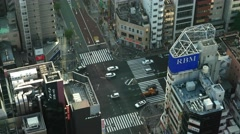 Tokyo - Aerial view with rooftops and junction with traffic and people. 4K Stock Footage