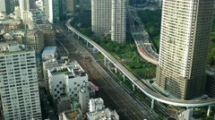 Tokyo - Aerial city view with trains and highway traffic. 4K resolution Stock Footage