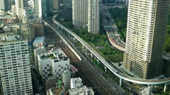 Tokyo - Aerial city view with trains and highway traffic. 4K resolution speed up Stock Footage