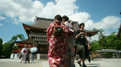 Kyoto - View of Yasaka Shrine with visitors in Japanese traditional clothes. - stock footage