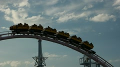 Yokohama - Roller coaster Vanish riding against blue sky at Yokohama Cosmoworld. - stock footage