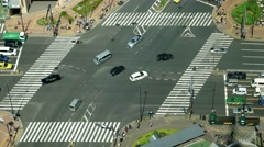 Tokyo - Aerial view of junction with traffic and people on crosswalk. 4K Stock Footage