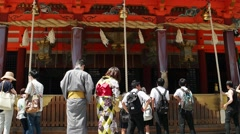 Kyoto - Visitors at Yasaka Shrine pulling ropes of Japanese Shinto bells. 4K - stock footage