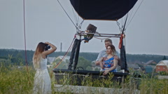 Adult couple posing for female photographer during fashion photo shoot outdoor Stock Footage