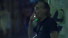 Smoker night in an urban environment Stock Footage