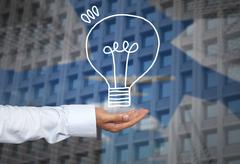 Drawing graphics lamp or bulb on hand to concept Creativity of new ideas in b Stock Photos