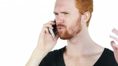 A young stressed angry depressed man aggressively talking on the phone Stock Footage