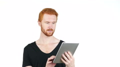 Young man doing a video call on a tablet pc  white background Stock Footage
