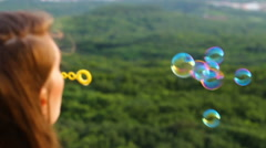 Girl blow bubbles Stock Footage