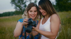 Female photographer showing photos for female model during fashion photo shoot Stock Footage