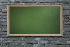 Blank old school blackboard on a grunge wall and can input text or data to wo - stock photo