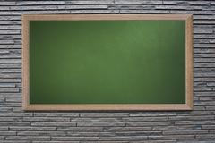 Blank old school blackboard on a grunge wall and can input text or data to wo Stock Photos