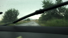 Driver POV, Rain splatters, obscures windshield, creates hazardous driving co Stock Footage