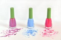 Three bottles of nail polish - stock photo