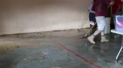 Flood Victims Squeegee Floor Stock Footage