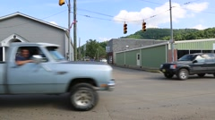 Cars Passing at Traffic Light in Small Town. Stock Footage