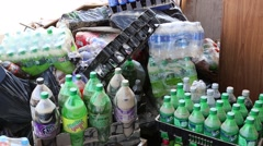 Flood Damaged and Discarded Soda Drink Bottles Stock Footage