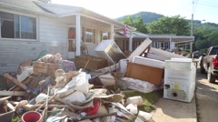 House with Flood Damaged Personal Effects Thrown Outside Stock Footage