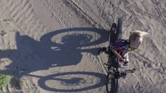 4k aerial pretty motocross girl puts her helmet on unique angle and shadow Stock Footage