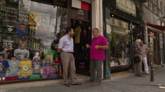 Shop keepers of a souvenirshop in Istanbul Stock Footage