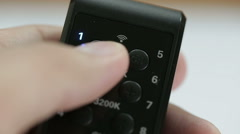 Remote control, wireless digital presses the button Stock Footage