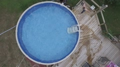 Guy cannonball into swimming pool slow mo Stock Footage