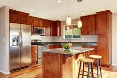 Spacious kitchen room with bar, stainless steel appliances, granite counter t - stock photo
