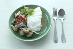 Curry chicken noodles (KHANOM CHIN) with vegetable. - stock photo