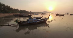 Wraparound Orbital Drone Shot of Traditional Thai Longtail Boats at Sunset Stock Footage