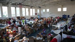 High Angle View of Volunteers and Relief Supplies in Building - stock footage