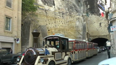LA VALLETTA - Tourist train coming from the tunnel Stock Footage