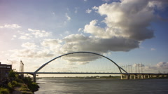 Modern traffic bridge and power cables crossing big river, 4K time lapse Stock Footage