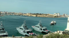 MALTA - Military boats on channel between La Valleta and Sliema city Stock Footage