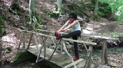 Fit woman exercising outdoors on parallel bars at park. Street workout spring Stock Footage