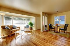 Open dining room with hardwood floor connected to dining room with teo black  Stock Photos